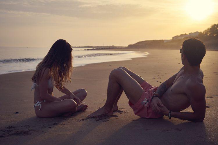 A guy and a girl on a beach