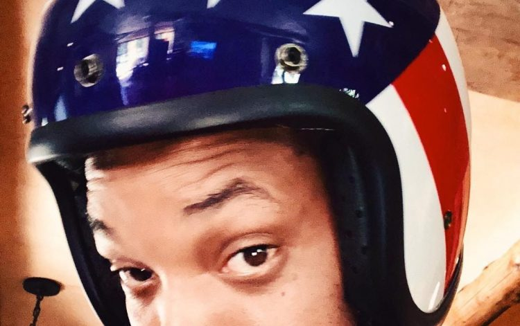 Actor Will Smith with a American flag motoring helmet.