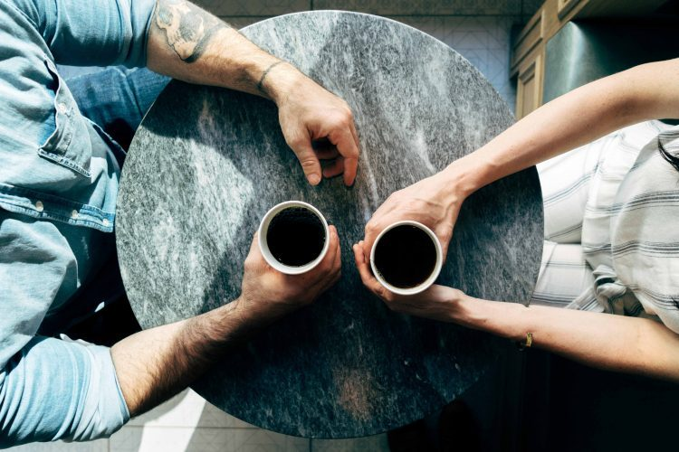A man and woman having a coffee date..