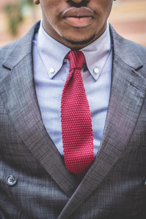 A man wearing a unique and well-tailored suit.